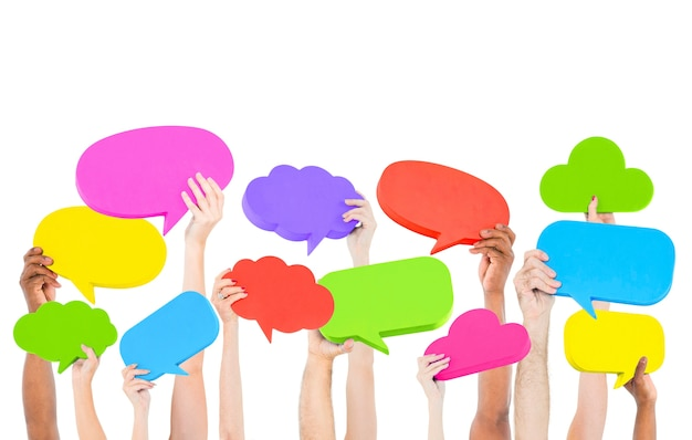 People holding colorful speech bubbles Premium Photo