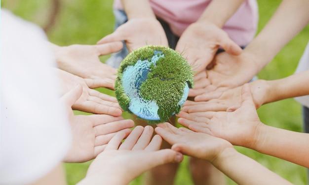People holding an earth miniature Premium Photo