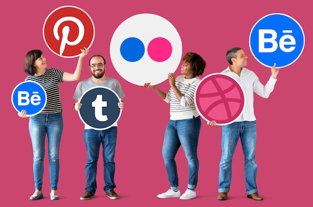 People holding icons of digital brands Premium Photo