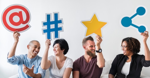 People holding an social media icon Premium Photo