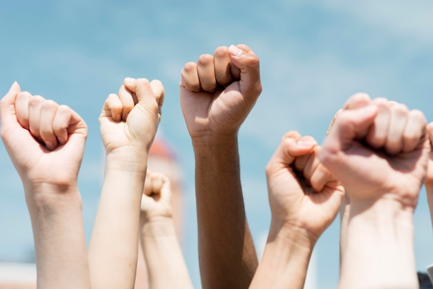 People holding their fists in the air Free Photo