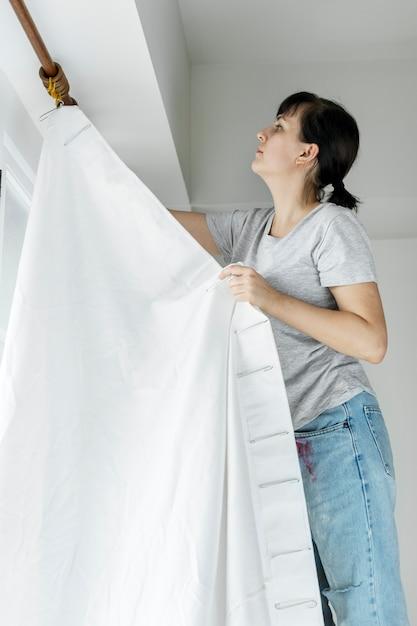 People installing window curtain Premium Photo