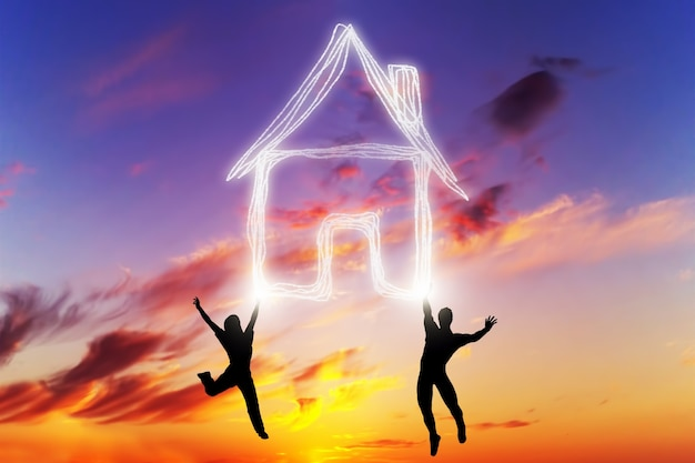 People jumping at sunset with a house Free Photo
