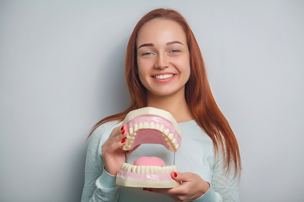 People, medicine, stomatology and healthcare concept - happy young female patient with big jaws. Premium Photo