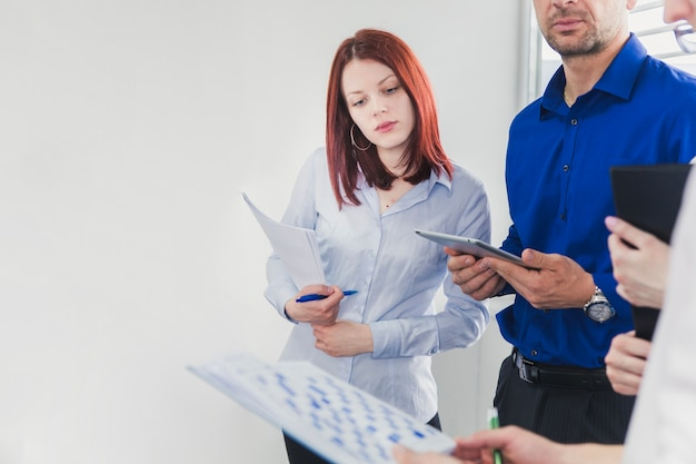 People in office watching documents Premium Photo