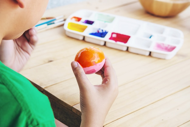 People painting colourful easter eggs - people celebration national holiday concept Free Photo