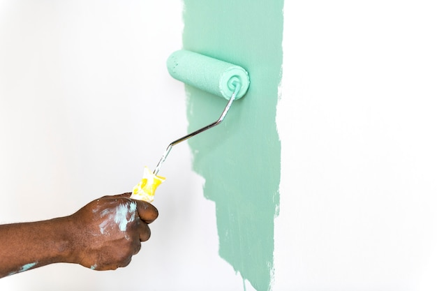 People painting house wall Free Photo