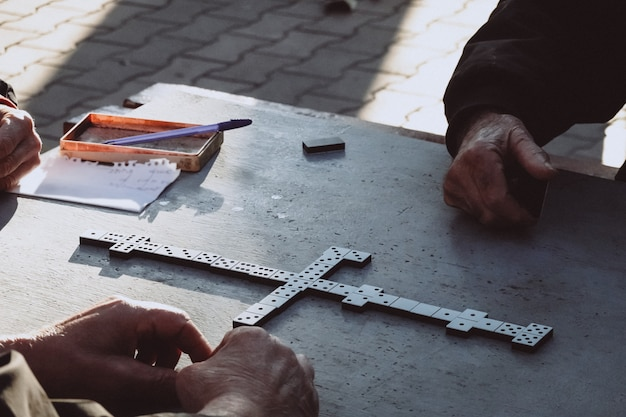 People playing the domino game in the park Free Photo