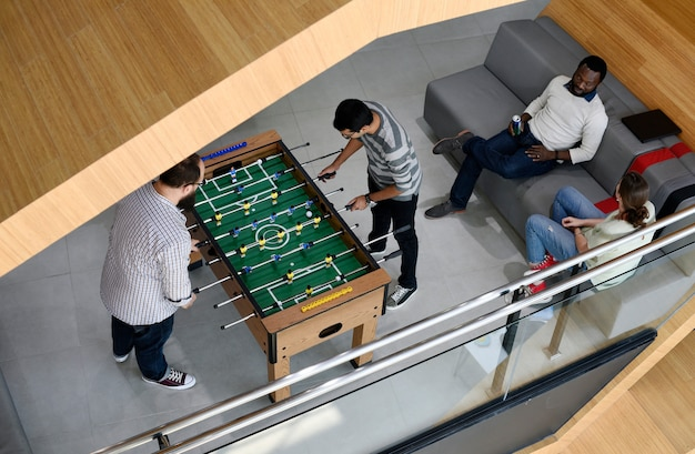 People playing enjoying foosball table soccer game recreation leisure Free Photo