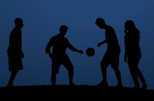 People playing football Premium Photo