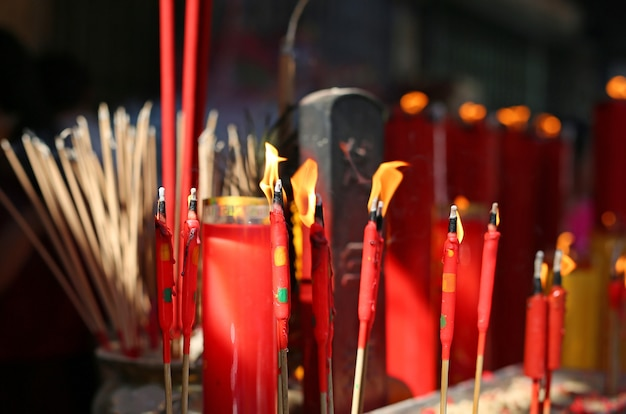 People pray respect with incense burning for god in chinese