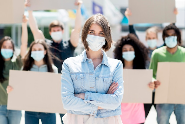 People protesting and wearing medical masks Free Photo