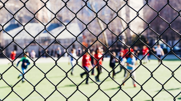 People resting in sports ground Free Photo
