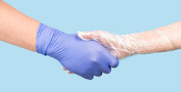 People shaking hands with gloves Premium Photo