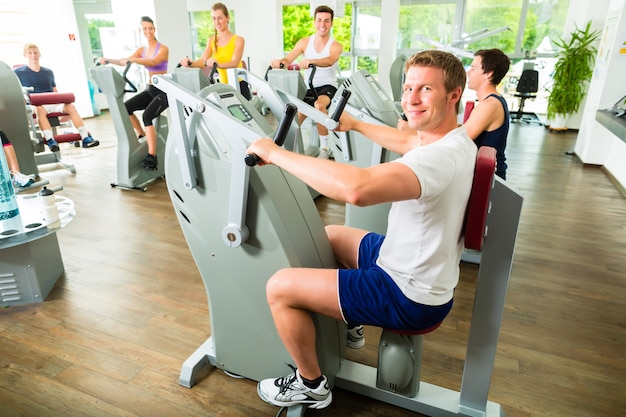 People in sport gym on machines Premium Photo