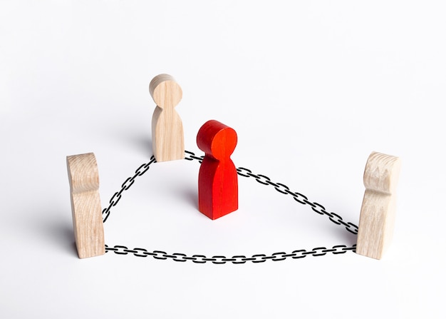 People surrounded the red man with chains. catch the criminal, neutralize the offender Premium Photo