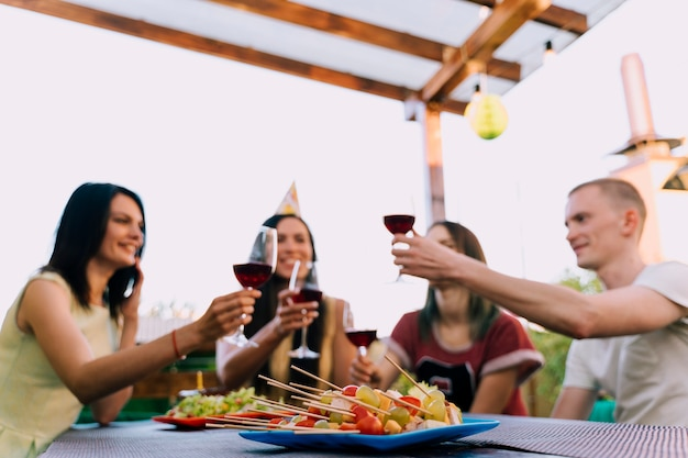 People toasting wine at party Free Photo