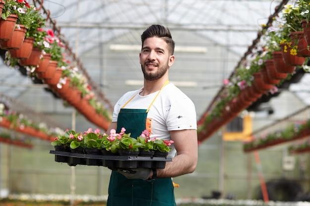 People working in a garden store Premium Photo