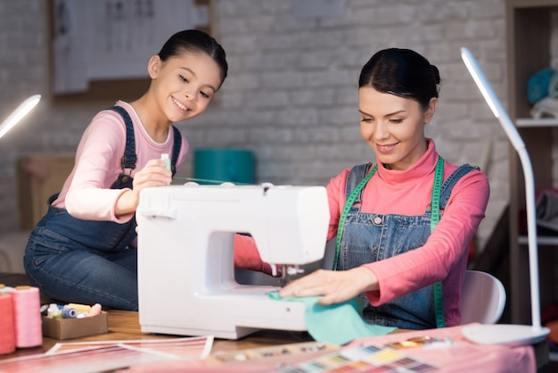People working together on the creation of clothes Premium Photo