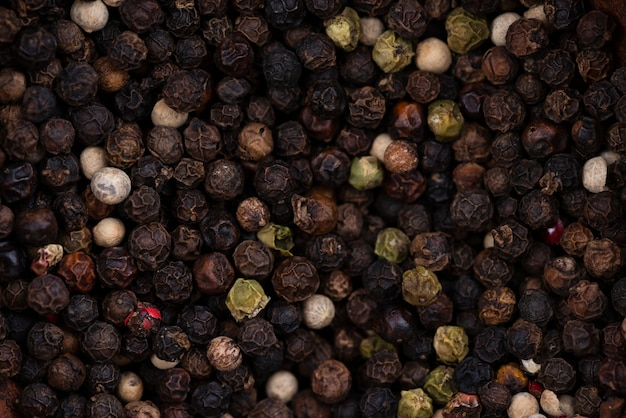 乾燥黒胡pepper背景のフラットレイアウト 無料写真