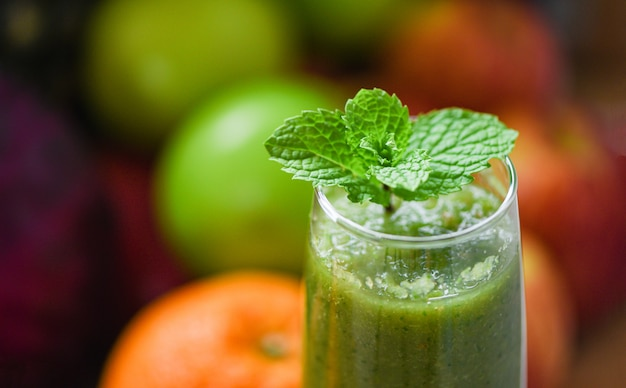 Peppermint tea green mint leaf on fresh vegetable juice smoothie and summer fruit Premium Photo