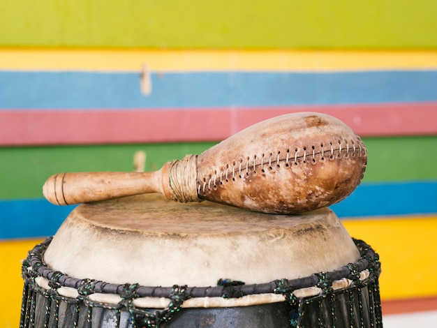 Percussion instruments with colorful wall behind Free Photo