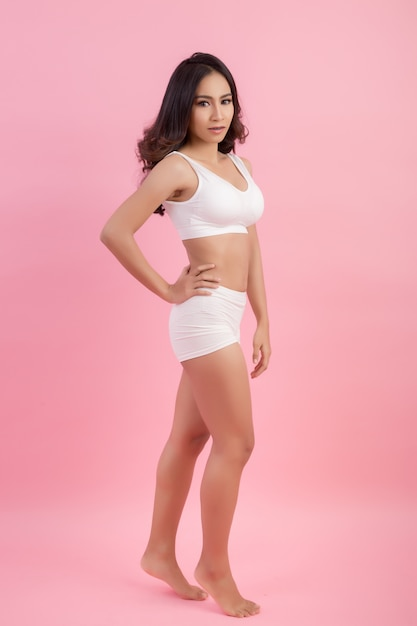 Perfect body of slim, fit and sporty woman in underwear Free Photo