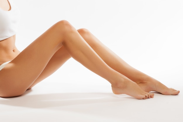 Perfect female legs, isolated on white background Premium Photo