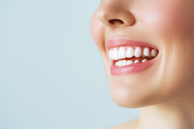 Perfect healthy teeth smile of a young woman. teeth whitening. dental care, stomatology concept. Premium Photo