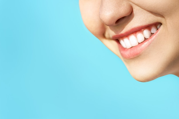 Perfect healthy teeth smile of a young woman. teeth whitening. dental clinic patient. stomatology concept. Premium Photo