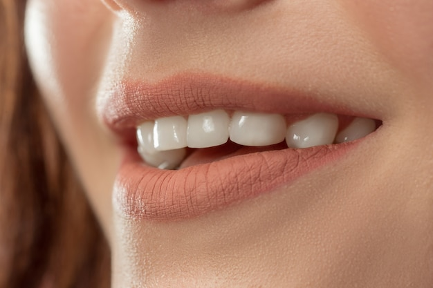 Perfect lips. sexy girl mouth close up. beauty young woman smile. natural plump full lip. lips augmentation. Free Photo