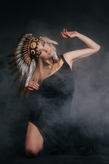 Perfect woman in garb of american indians in smoke Premium Photo