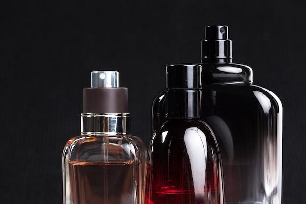Perfume bottle on dark Premium Photo