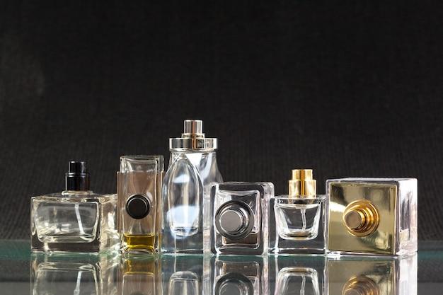 Perfume bottle on a dark Premium Photo
