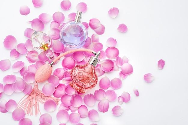 Perfume bottles with flower petals. perfumery, cosmetics, fragrance collection Premium Photo