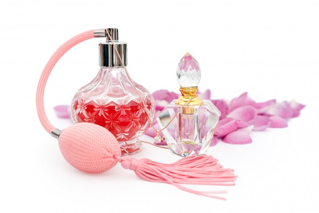 Perfume bottles with flower petals. perfumery, cosmetics, fragrance collection Premium Photo