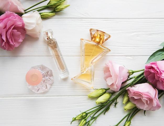 Perfume bottles with flowers Premium Photo