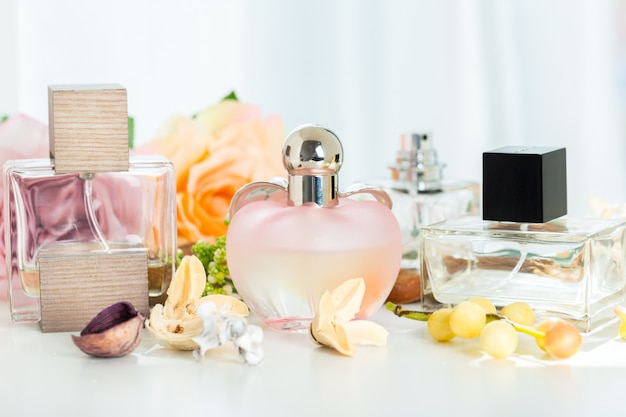 Perfume bottles with flowers Premium Photo