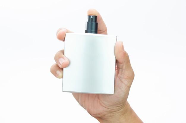 Perfume spray bottle in man hand Premium Photo