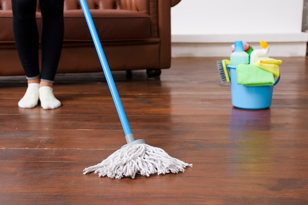 Person cleaning hardwood floor at home Free Photo