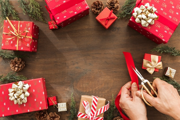 Person cutting red ribbon on brown table Free Photo