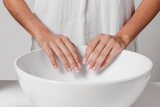 Person drying her hands above sink Free Photo