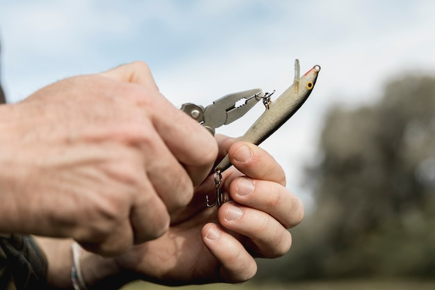 Person fixing a fish hook Free Photo