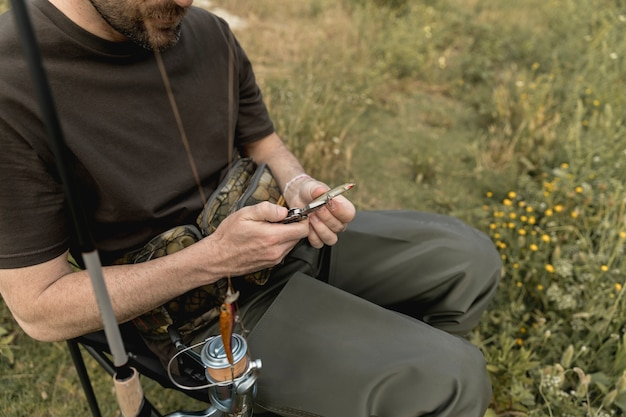 Person fixing a fish hook Photo | Free Download