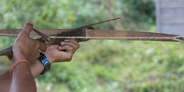Person hand aiming with crossbow, luang prabang, laos Premium Photo