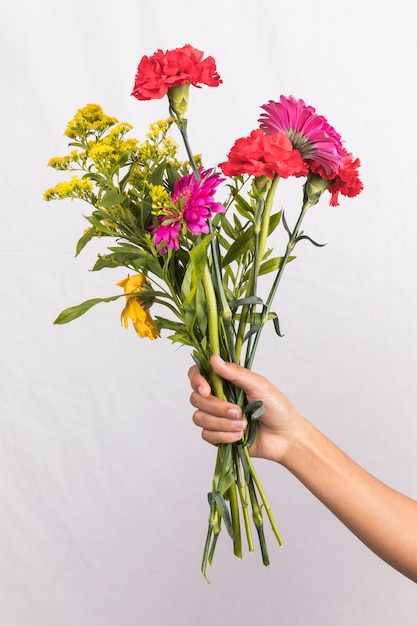 31111c7b9 Person holding big flowers bouquet Photo   Free Download