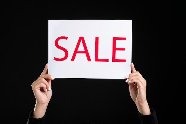 Person holding big sale white banner Premium Photo