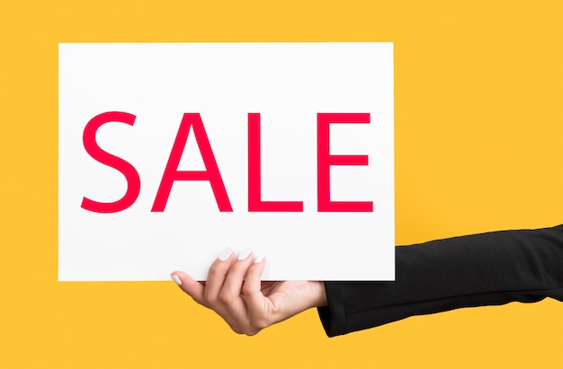 Person holding black friday sale banner Free Photo