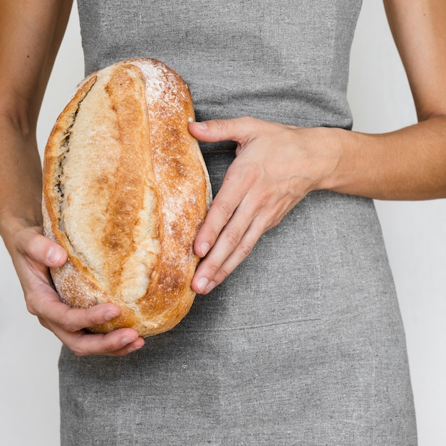 Person holding bread loaf Free Photo
