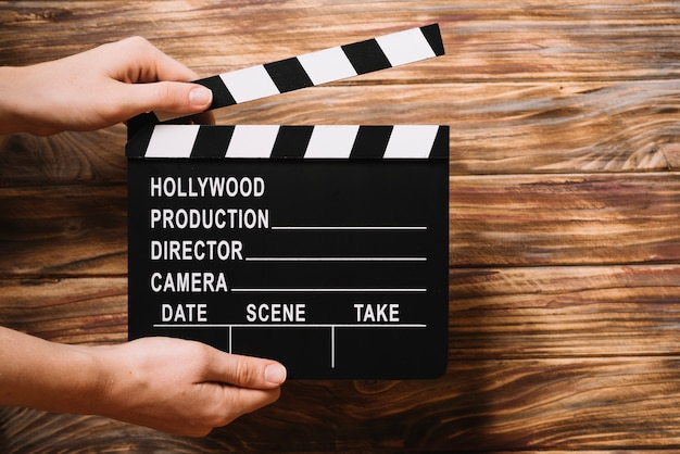 Person holding clapperboard Free Photo